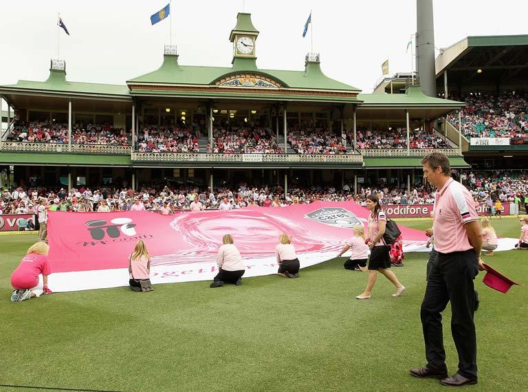 SYDNEY, AUSTRALIA - JANUARY 05:  Glenn McGrath walks past the pink silk of his late wife Jane ahead of day three of the Second Test Match between Australia and India at Sydney Cricket Ground on January 5, 2012 in Sydney, Australia.  (Photo by Hamish Blair/Getty Images)