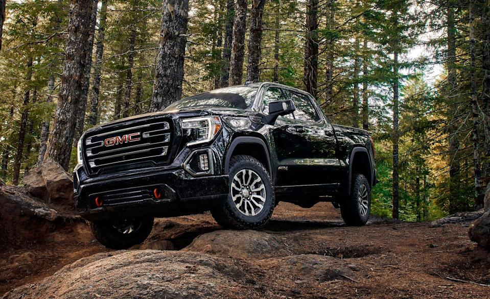 "<p>The <a href=""https://www.caranddriver.com/gmc/sierra-1500"" rel=""nofollow noopener"" target=""_blank"" data-ylk=""slk:GMC Sierra 1500"" class=""link rapid-noclick-resp"">GMC Sierra 1500</a>'s AT4 trim is step up in ability from the less expensive X31 Off-Road package available on other Sierras. Both come with a rear electronic-locking differential, Rancho monotube shocks, hill-descent control, a two-speed transfer case, and lots of skid plates, but only the AT4 has the 2.0-inch suspension lift. That's worth a few shekels. Beyond that, it is available with an Off-Road drive mode that is designed for higher-speed travel on unpaved surfaces. For 2020, there's an AT4 CarbonPro Edition with a CarbonPro composite bed, a black chrome finish grille surround, special badging, black dual exhaust tips, and 18-inch wheels with Goodyear DuraTrac tires. The AT4 trim can be had with the top-dog 420-hp 6.2-liter V-8.</p>"