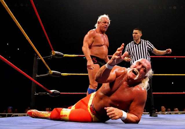 <p>Hulk Hogan grimaces in pain as his opponent Ric Flair stands over him during Hulk Hogan's Hulkamania Tour at Rod Laver Arena on November 21, 2009 in Melbourne, Australia. (Photo by Mark Dadswell/Getty Images) </p>