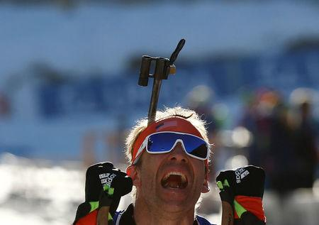 Biathlon - IBU World Championships - Men's 15km Individual - Hochfilzen, Austria - 16/2/17 -    Lowell Bailey from the U.S. reacts.  REUTERS/Leonhard Foeger