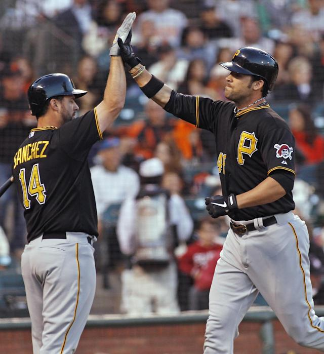 Pittsburgh Pirates' Garrett Jones, right, gets a high-five from Gaby Sanchez after hitting a home run against the San Francisco Giants during the second inning of a baseball game in San Francisco, Thursday, Aug. 22, 2013. (AP Photo/George Nikitin)