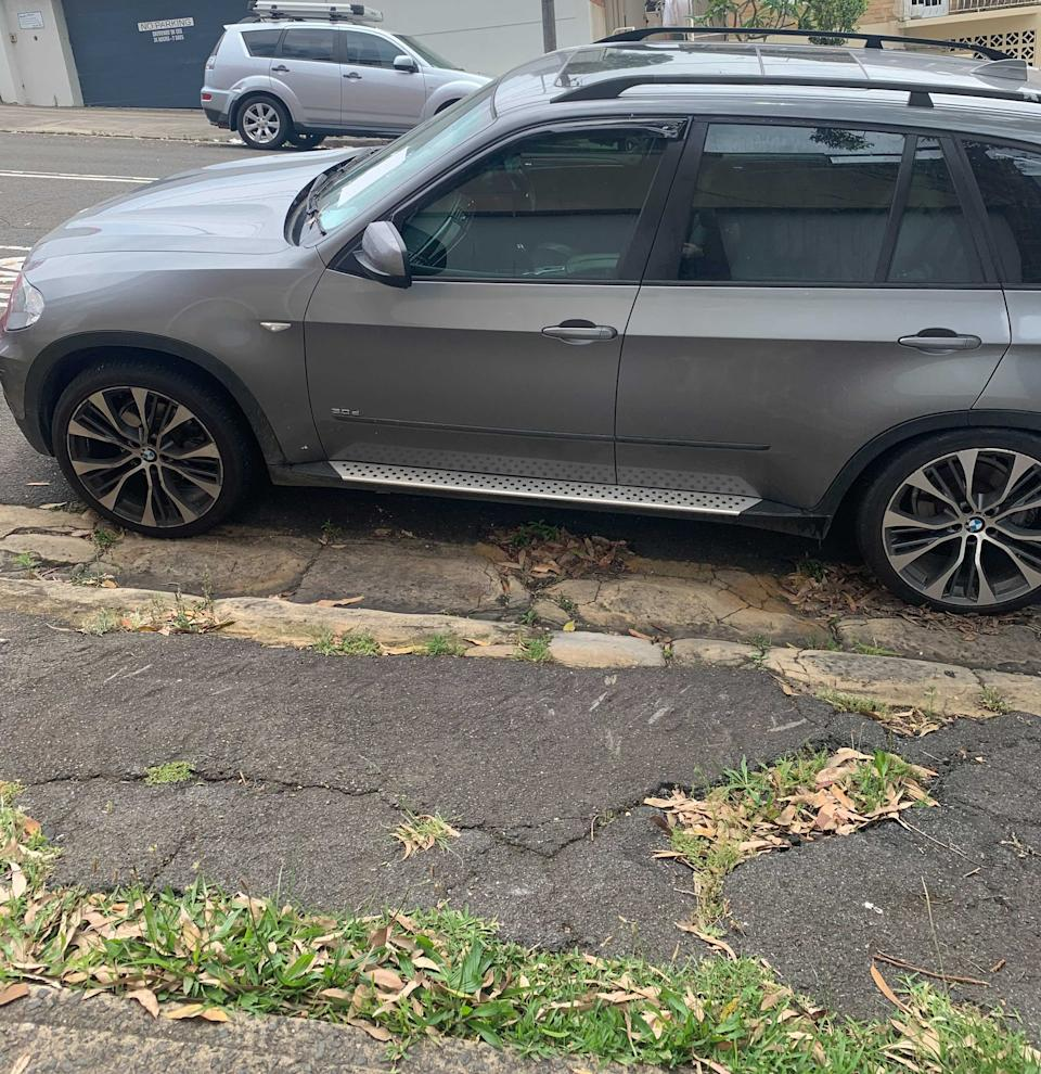 Car parked in front of a driveway
