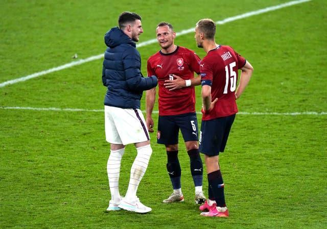 Declan Rice (left) speaks with West Ham team-mates Vladimir Coufal and Tomas Soucek