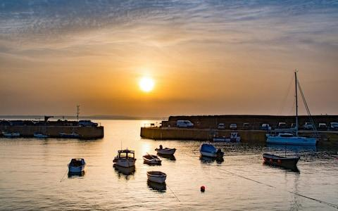 The view this morning at Mousehole Harbour, Cornwall - Credit: Alamy