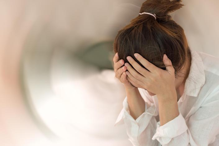 Bacterial infections can cause severe headache as well as stiff neck and back. Image via Getty Images.