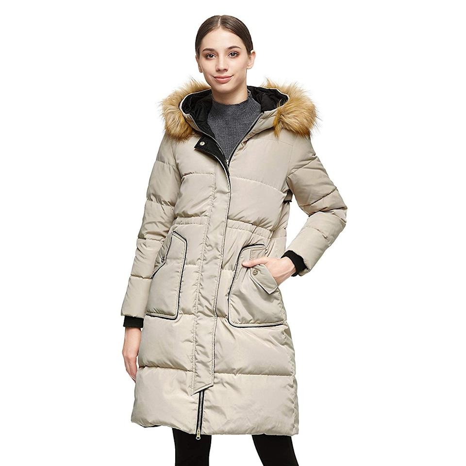 """<p>With sharp details like ribbed cuffs and contrast piping along the front two pockets, this cozy piece may give the original a run for its money.</p> <p><strong>Shop Now: </strong>$120<strong>; </strong><a href=""""https://www.amazon.com/Orolay-Womens-Winter-Casual-Removable/dp/B07RLQW6YR/ref=as_li_ss_tl?ie=UTF8&linkCode=ll1&tag=isfasorolaypuffercoatsamazonjmattern0219-20&linkId=ecca8fa1a52d36c38816f908a12923ad"""" target=""""_blank"""">amazon.com</a></p>"""