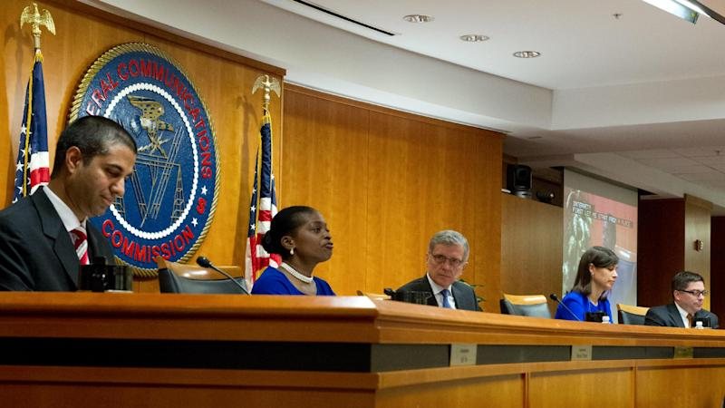 L-R: FCC Commissioner Ajit Pai, Commissioner Mignon Clyburn, FCC Chairman Tom Wheeler, Jessica Rosenworcel, and Michael O'Rielly are seen during a meeting in Washington, DC on May 15, 2014 (AFP Photo/Karen Bleier)