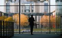 A man stands inside the Paul Loebe building ahead of the arrival of Wirecard's former boss Markus Braun, in Berlin