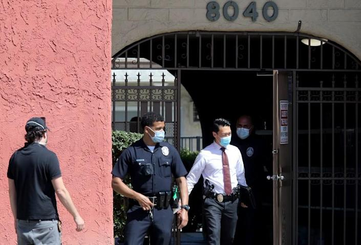 RESEDA, CA - APRIL 10, 2021:. Police conduct an investigation at an apartment building in Reseda where three children were reportedly stabbed to death by their mother on Saturday, April 10, 2021. The mother fled the scene but was later apprehended in the San Joaquin Valley. (Luis Sinco / Los Angeles Times)