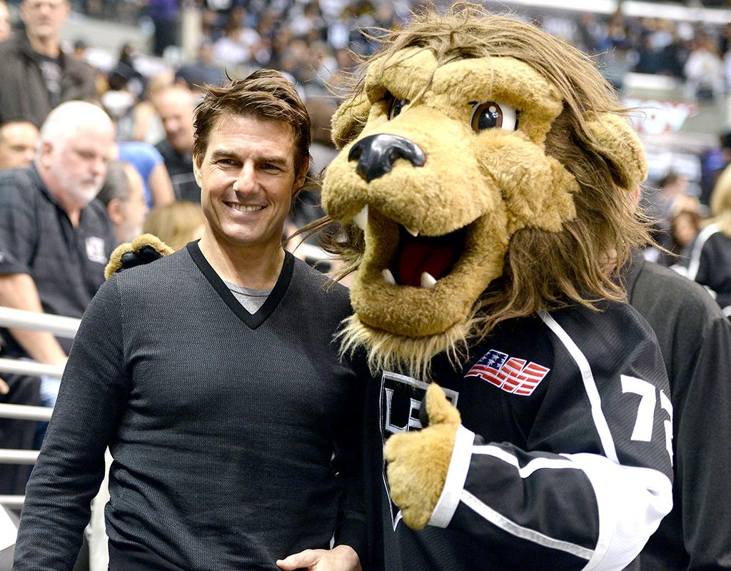 "Tom Cruise poses for photos with all kinds of fans, but this one is a bit unusual. The ""Oblivion"" actor bumped into Bailey the Lion -- who serves as pro hockey team the Los Angeles Kings' maned mascot -- when he hit Game Five of the Stanley Cup Playoff's Western Conference Semifinals at Staples Center on Thursday. (5/23/2013)"