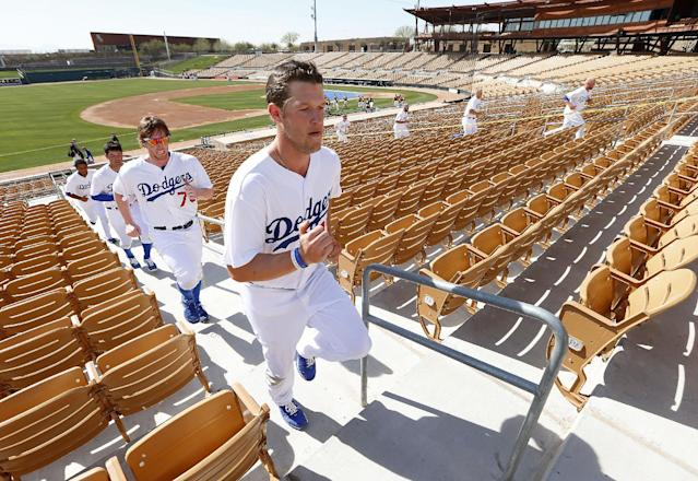 Los Angeles Dodgers pitcher Clayton Kershaw leads teammates running stairs during spring training baseball practice in Glendale, Ariz., Friday, Feb. 14, 2014