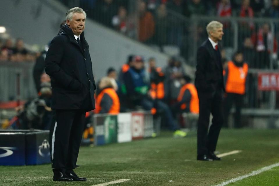 Bayern Munich's head coach Carlo Ancelotti (L) and Arsenal's French manager Arsene Wenger follow the action from the sideline during the UEFA Champions League round of sixteen football match February 15, 2017 (AFP Photo/Odd ANDERSEN)