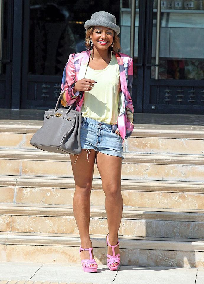 """Someone tell Christina Milian it's fall, not spring ... even if she was in sunny L.A. The singer-turned-""""Voice"""" correspondent donned a floral blazer, baby pink heels, light yellow tee, jean cutoffs <span style=""""font-size:11.0pt; """">–</span> and a wool bowler hat? <span style=""""font-size:11.0pt; """">–</span> for a shopping spree at Barneys New York. (9/25/2012)"""