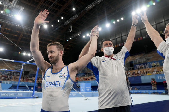 Artem Dolgopyat of Israel, left, celebrates after winning the gold medal on the floor exercise during the artistic gymnastics men's apparatus final at the 2020 Summer Olympics, Sunday, Aug. 1, 2021, in Tokyo. (AP Photo/Natacha Pisarenko)