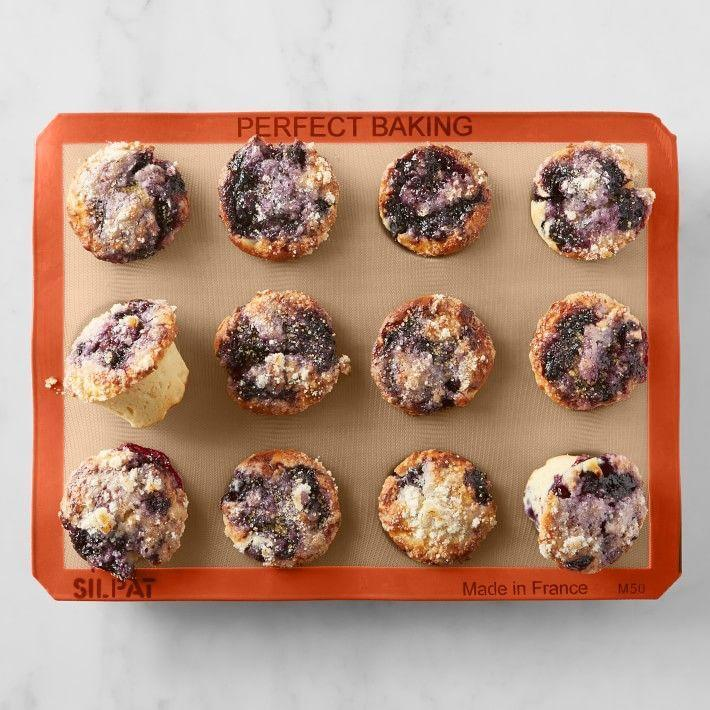 """<p><strong>Silpat</strong></p><p>williams-sonoma.com</p><p><strong>$59.95</strong></p><p><a href=""""https://go.redirectingat.com?id=74968X1596630&url=https%3A%2F%2Fwww.williams-sonoma.com%2Fproducts%2Fsilpat-silicone-muffin-pan-12-well&sref=https%3A%2F%2Fwww.womenshealthmag.com%2Ffood%2Fg19983997%2Fkitchen-gifts%2F"""" rel=""""nofollow noopener"""" target=""""_blank"""" data-ylk=""""slk:Shop Now"""" class=""""link rapid-noclick-resp"""">Shop Now</a></p><p>Developed by French pasty chefs and used in professional kitchens, this Silpat muffin pan is made with a flexible fiberglass fabric, which perfectly conducts heat for a flawless end product, whether you're making muffins, egg bites, or mini quiches. Plus, it's coated in food-grade silicone to ensure an easy nonstick finish. </p>"""