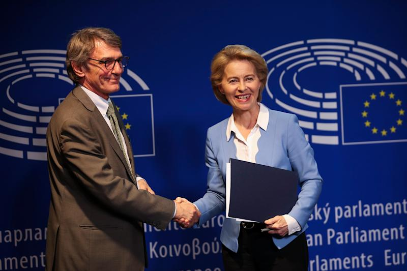 German Defense Minister and candidate for European Commission President Ursula von der Leyen, right, shakes hands with new elected President of the European Parliament David Sassoli after their meeting at the European Parliament in Brussels, Wednesday, July 10, 2019. European Parliament groups are grilling the German candidate for European Commission president before they take a vote on her appointment next week. (AP Photo/Francisco Seco)