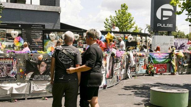 PHOTO: Survivors and their supporters gather at Pulse in downtown Orlando on the fifth anniversary of the mass shooting that took 49 lives, June 12, 2021. (Craig Bailey/Florida Today via USA Today Network)