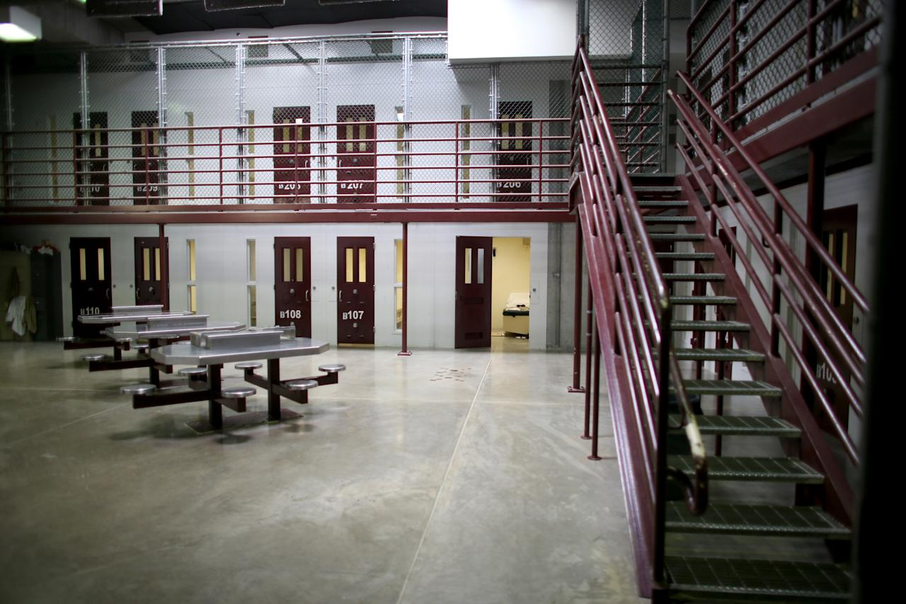 GUANTANAMO BAY, CUBA - JUNE 25: (EDITORS NOTE: Image has been reviewed by the U.S. Military prior to transmission.) Prison cells are viewed in camp 6 where prisoners are housed in a communal facility at the U.S. military prison for 'enemy combatants' on June 25, 2013 in Guantanamo Bay, Cuba. President Barack Obama has recently spoken again about closing the prison which has been used to hold prisoners from the invasion of Afghanistan and the war on terror since early 2002. (Photo by Joe Raedle/Getty Images)