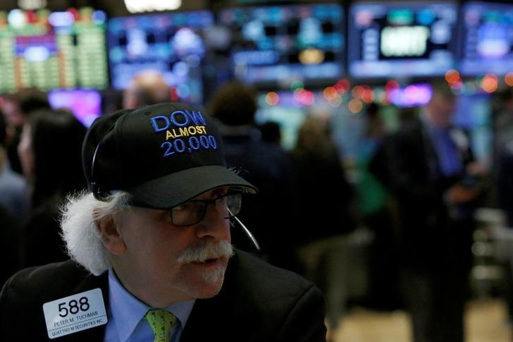 Trader Peter Tuchman works on the floor at the New York Stock Exchange (NYSE) in Manhattan, New York City, U.S.
