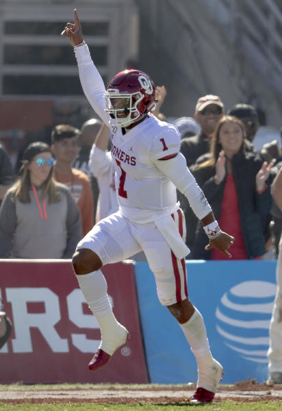 Oklahoma quarterback Jalen Hurts (1) celebrates a touchdown against Texas during the first half of an NCAA college football game at the Cotton Bowl, Saturday, Oct. 12, 2019, in Dallas. (Nick Wagner/Austin American-Statesman via AP)