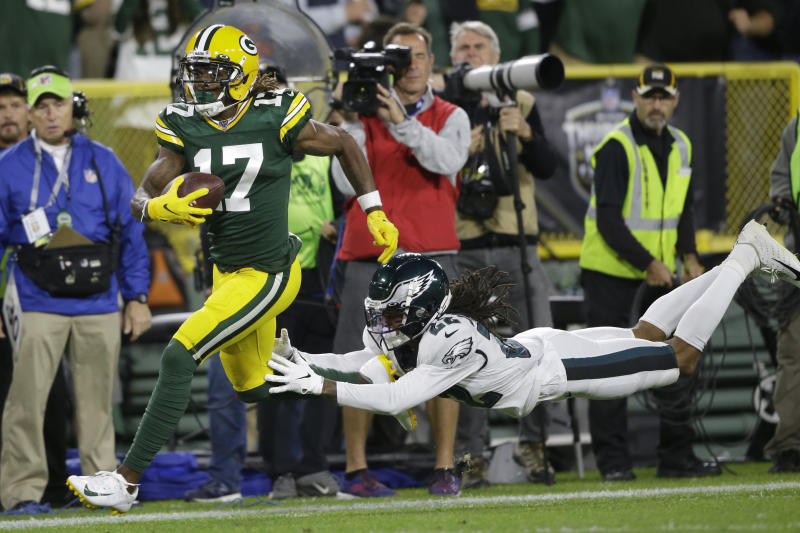 Green Bay Packers wide receiver Davante Adams runs from the defense of Philadelphia Eagles cornerback Sidney Jones after making a catch during the first half of an NFL football game Thursday, Sept. 26, 2019, in Green Bay, Wis. (AP Photo/Jeffrey Phelps)