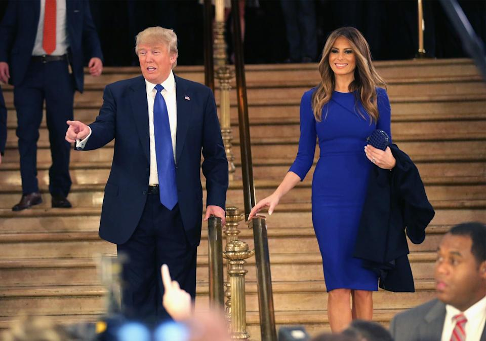 <p>For a presidential debate look, Melania stuck to her usual fitted style in a royal blue midi-length dress and matching box clutch. <i>[Photo: Getty]</i> </p>