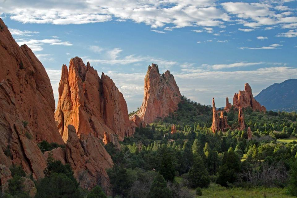 """<p><strong>Garden of the Gods </strong></p><p>Explore what Colorado Springs has to offer in one magical place. <a href=""""https://www.gardenofgods.com/"""" rel=""""nofollow noopener"""" target=""""_blank"""" data-ylk=""""slk:Garden of the Gods"""" class=""""link rapid-noclick-resp"""">Garden of the Gods</a> is a registered National Natural Landmark, with dramatic views, 300 foot sandstone rock formations along a backdrop of mountainous views and blue skies.</p>"""