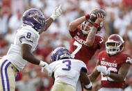 Oklahoma quarterback Spencer Rattler (7) is defended by Western Carolina defensive back LA Rogers-Anderson (8) and safety Jacob Harris (3) defend during the first half of an NCAA college football game Saturday, Sept. 11, 2021, in Norman, Okla. (AP Photo/Alonzo Adams)