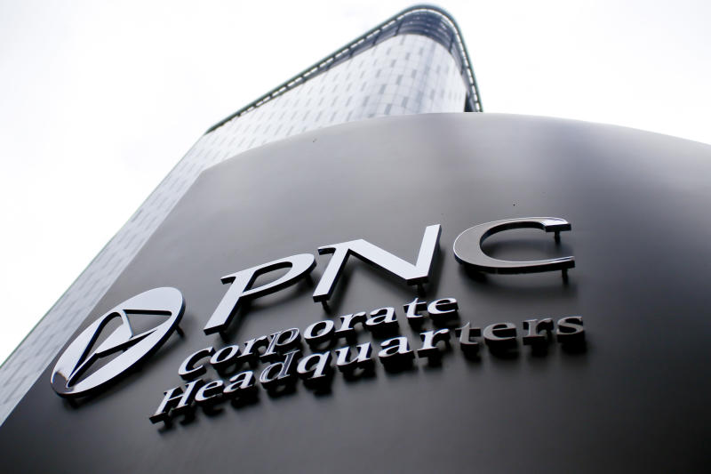 A sign for PNC Corporate Headquarters marks the block where the offices for the banking corporation are in downtown Pittsburgh on Monday, Oct. 16, 2017, in Pittsburgh. (AP Photo/Keith Srakocic)
