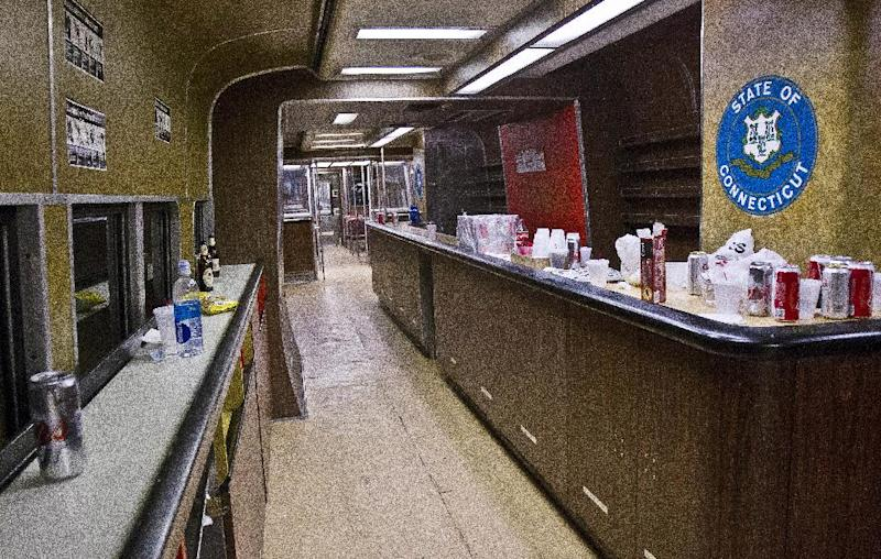 The bar car on the 7:07 p.m. train from Grand Central Terminal in New York to New Haven, Conn., is empty of riders after its run on Thursday, May 8, 2014. The bar car is near the end of its run as Metro-North is retiring it from the New Haven Line after Friday's afternoon rush hour. The cars were a fixture on Metro-North Railroad trains for at least a half century. For some riders, they were more than a place to have a drink on the long ride home from work. Commuters played dice, formed friendships, talked business, pulled pranks and even had Christmas parties with a jazz band. (AP Photo/Michael R. Sisak)