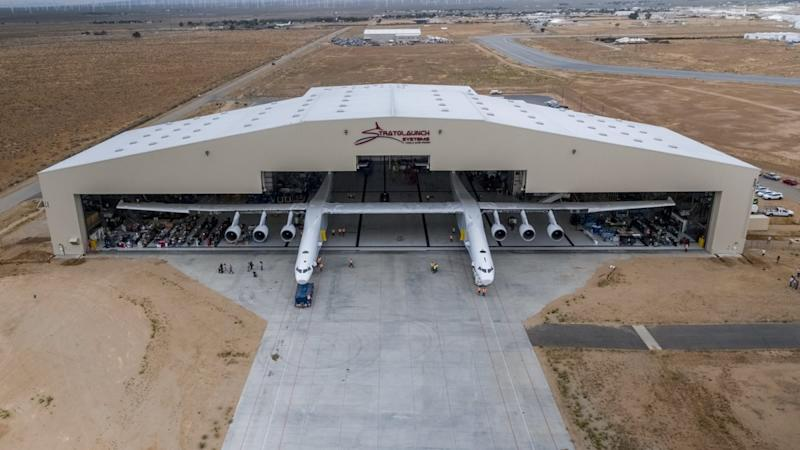 Stratolaunch Roc airplane leaving its hangar