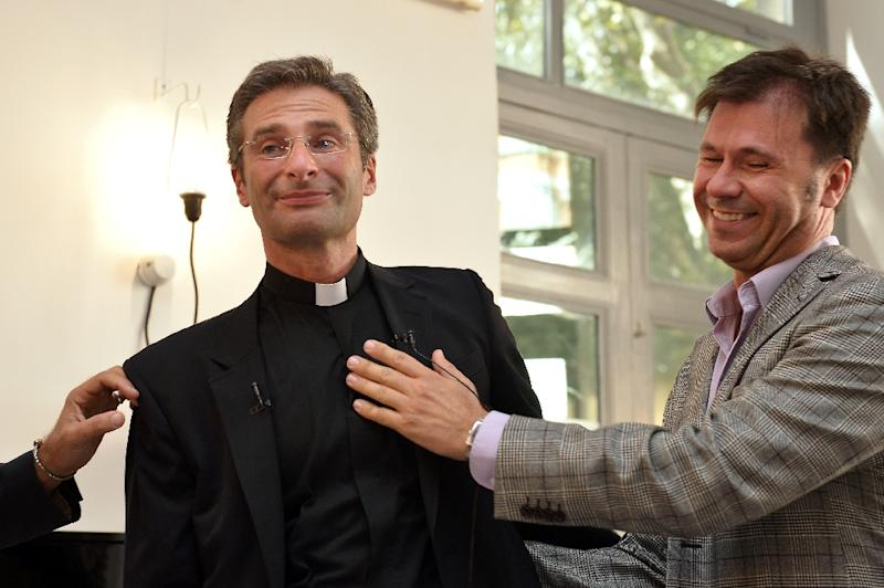Father Krysztof Olaf Charamsa (L), who works for a Vatican office, gives a press conference with his partner Edouard to reveal his homosexuality on October 3, 2015 in Rome (AFP Photo/Tiziana Fabi)