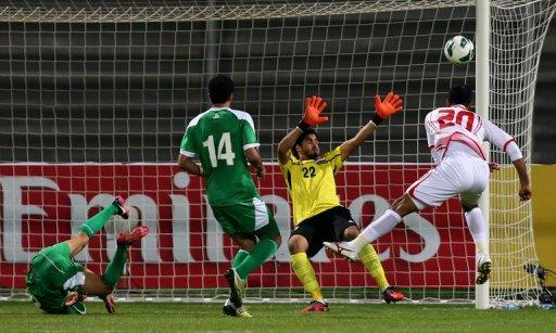 Ali Salem (R) of UAE heads the ball during the 21st Gulf Cup final between UAE and Iraq on January 18, 2013 in Manama