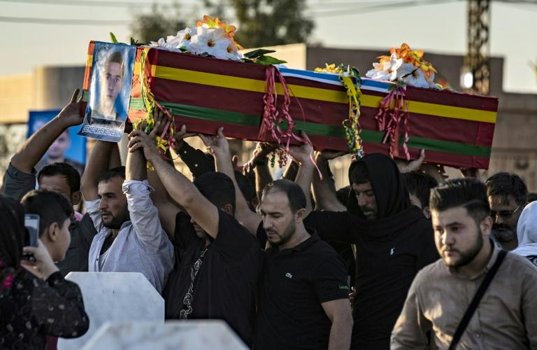Mourners attend the funeral of five Syrian Democratic Forces fighters killed in battles against Turkey-led forces in the flashpoint town of Ras al-Ain
