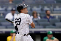 New York Yankees' Gio Urshela hits a go-ahead solo home run off Oakland Athletics relief pitcher Jesus Luzardo in the eighth inning of a baseball game, Saturday, June 19, 2021, in New York. (AP Photo/John Minchillo)