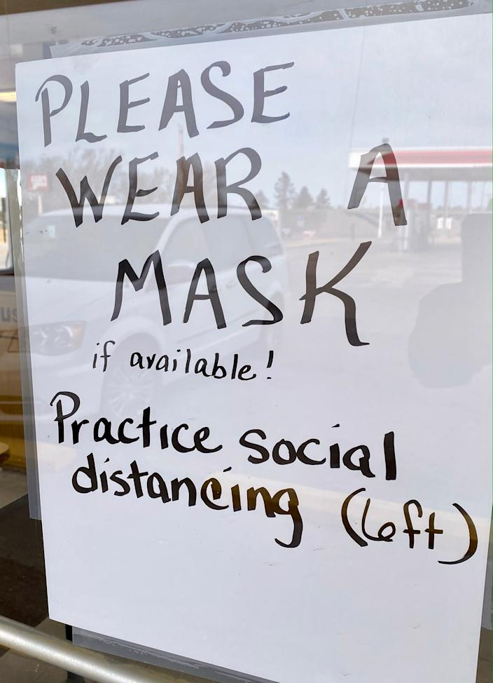 A sign on the Dairy Queen in Quinter, Kansas, asks customers to wear masks if they have them. At the time the photo was taken, the county required masks in public places, but many people ignored the protocol.