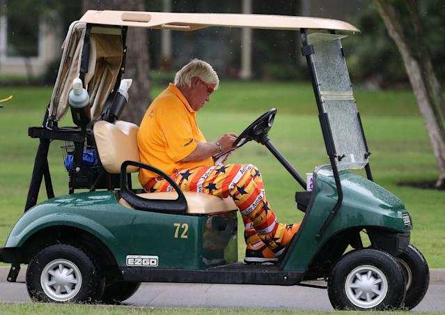 John Daly, 53, is being allowed to use a cart with no roof because of arthritis in his right knee. (Getty)