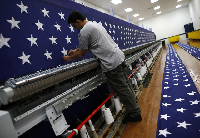 <p>A worker inspects a sheet of stars after embroidery at the FlagSource facility in Batavia, Illinois, U.S., on Tuesday, June 27, 2017. (Photo: Jim Young/Bloomberg via Getty Images) </p>
