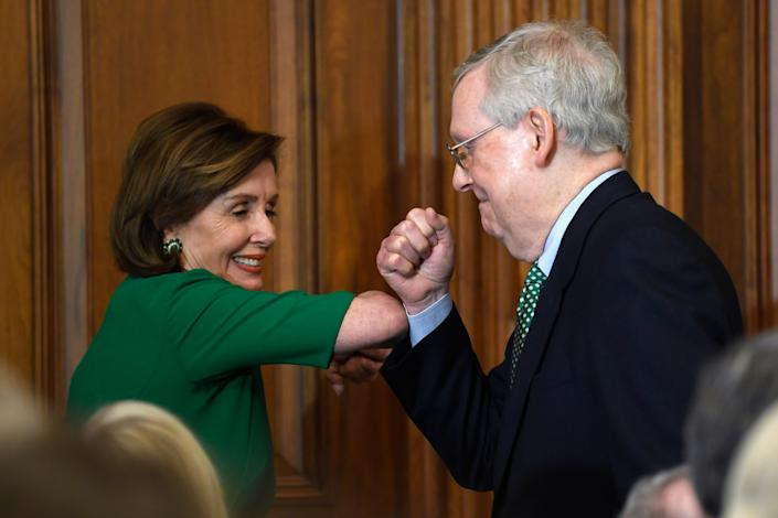 House Speaker Nancy Pelosi, D-Calif., and Senate Majority Leader Mitch McConnell, R-Ky., bump elbows as they attend a lunch with Irish Prime Minister Leo Varadkar on Capitol Hill in Washington on March 12.