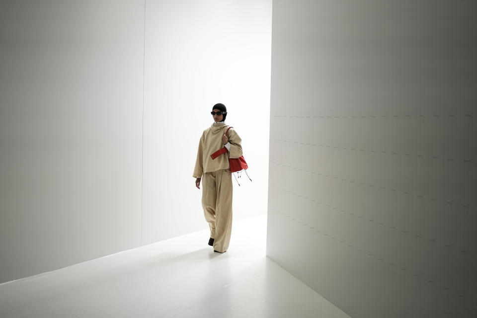 A model wears a creation for the Sunnei Spring Summer 2022 collection during Milan Fashion Week, in Milan, Italy, Friday, Sept. 24, 2021. (AP Photo/Antonio Calanni)