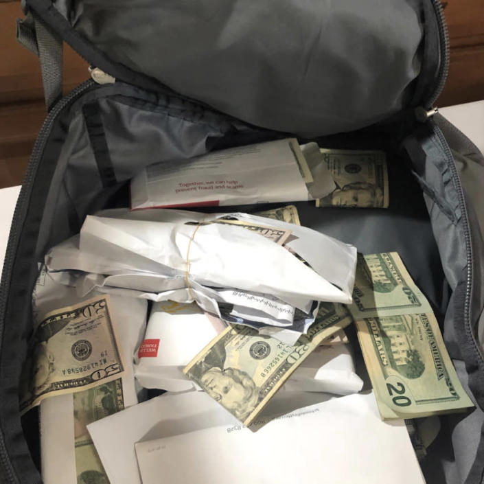 Image: At Nyugen Social Services, investigators uncovered in cash stuffed in a backpack. (Orange County District Attorney)