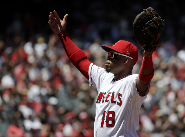 Los Angeles Angels third baseman Luis Valbuena reacts after San Francisco Giants' Brandon Belt flew out during the first inning of a baseball game in Anaheim, Calif., Sunday, April 22, 2018. (AP Photo/Chris Carlson)