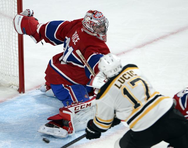Montreal Canadiens goalie Carey Price (31) makes a save against Boston Bruins left wing Milan Lucic (17) during the second period in Game 4 in the second round of the NHL Stanley Cup playoffs Thursday, May 8, 2014, in Montreal. (AP Photo/The Canadian Press, Ryan Remiorz)