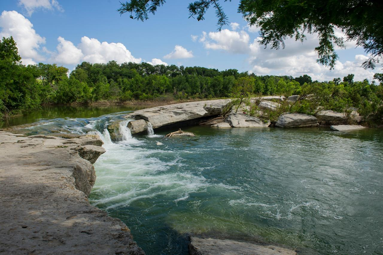 "<p><strong>Let's start big picture. What's the vibe here?</strong><br> Located due east of downtown Austin, McKinney Falls State Park has smooth limestone pools and waterfalls, making for a striking change from the rest of the city's landscape. The park is best for swimming and hiking; those who boulder or mountain-bike will also find great spots for adrenaline-pumping adventure. Visitors looking to stay the night will be glad to know there's 81 campsites, as well as six recently remodeled cabins.</p> <p><strong>Any standout features or must-sees?</strong><br> The upper and lower falls are undoubtedly the main draws of this park, and the best time to visit is when the water is steadily flowing. Of course, everybody else seems to know this; expect the crowds to swell in sync with the falls. The Homestead Trail leads to a historic settler's stone house and gristmill, another unique draw of the park.</p> <p><strong>Was it easy to get around?</strong><br> Visitors are given a map by park rangers upon entering, and will find the grounds quite easy to navigate. There are plenty of picnic areas and rocks for resting, and the paved Onion Creek Hike and Bike Trail offers an easy 2.8-mile option for those with strollers or mobility issues.</p> <p><strong>All said and done, what—and who—is this best for?</strong><br> The entrance fee for adults is $6; children 12 and under are free. The best way to use time wisely is to arrive early, especially during in summer when Austinites flock to the falls for cool relief. Once the park is full, the rangers at the front gate will enforce a ""one in, one out"" policy, so you could get stuck waiting in a line of cars to enter. This is also a popular park for pet owners, as leashed dogs are allowed on the trails and campsites.</p>"