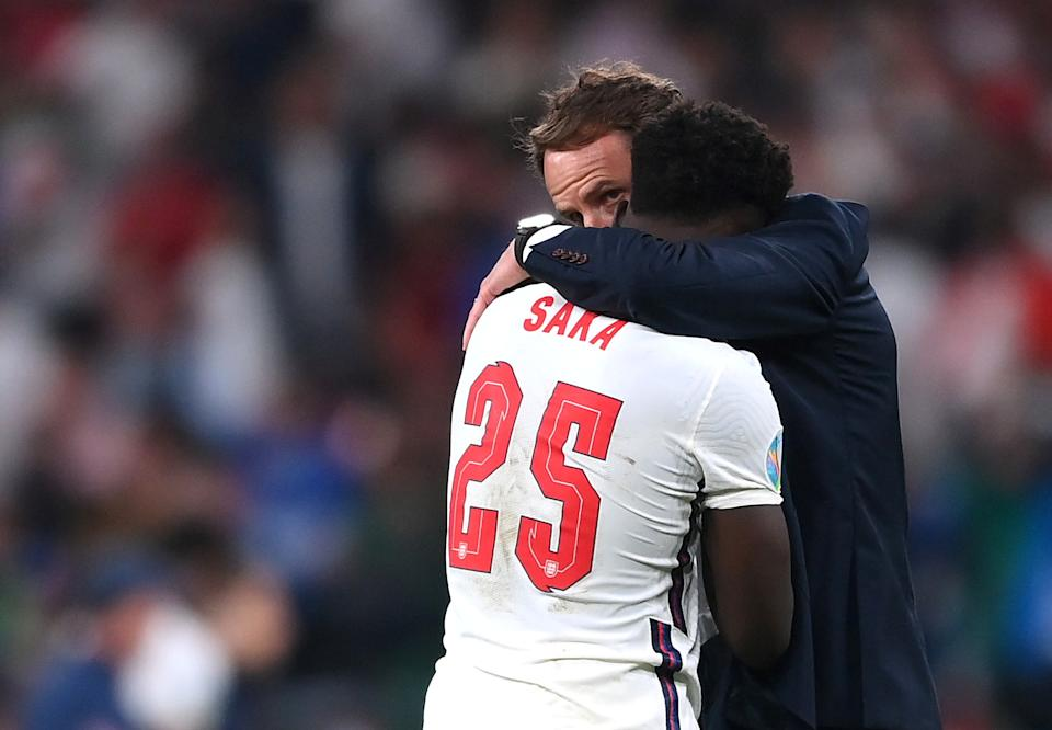 Soccer Football - Euro 2020 - Final - Italy v England - Wembley Stadium, London, Britain - July 11, 2021 England's Bukayo Saka with manager Gareth Southgate after the match Pool via REUTERS/Laurence Griffiths     TPX IMAGES OF THE DAY