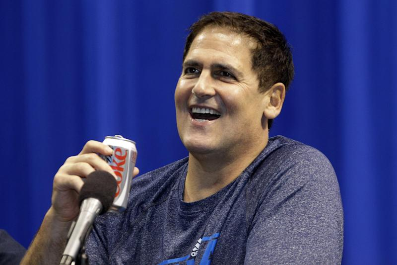 Dallas Mavericks owner Mark Cuban laughs during an NBA basketball news conference introducing new Mavericks players at American Airlines Center in Dallas, Monday, Sept. 10, 2012. (AP Photo/LM Otero)