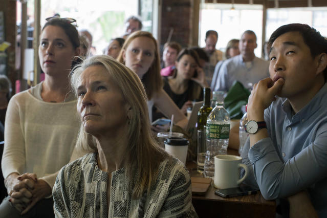 <p>People watch as former FBI director James Comey testifies during a Senate Intelligence Committee hearing, June 8, 2017, at the Building on Bond in the Brooklyn borough of New York. (Mary Altaffer/AP) </p>