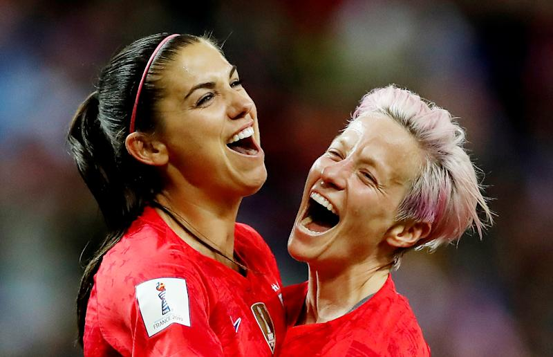 Soccer Football - Women's World Cup - Group F - United States v Thailand - Stade Auguste-Delaune, Reims, France - June 11, 2019 Alex Morgan of the U.S. celebrates scoring their twelfth goal with Megan Rapinoe REUTERS/Christian Hartmann