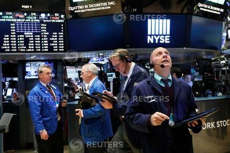 Traders work on the floor of the New York Stock Exchange (NYSE) in New York