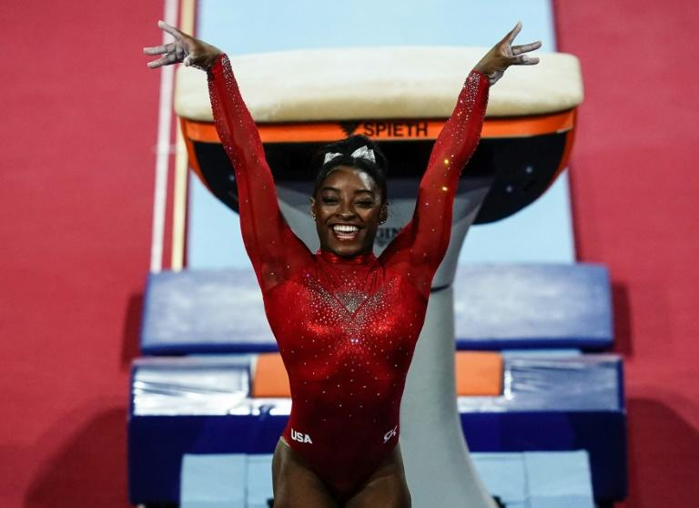 Simone Biles claimed a record-equalling 23rd world championship medal on Saturday